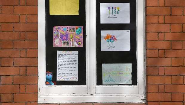 Messages of support for the residents are displayed in the windows of Peel Moat care home in Stockpo