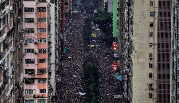 Hundreds of thousands protesters march through the streets of Hong Kong, China, demanding for it's l