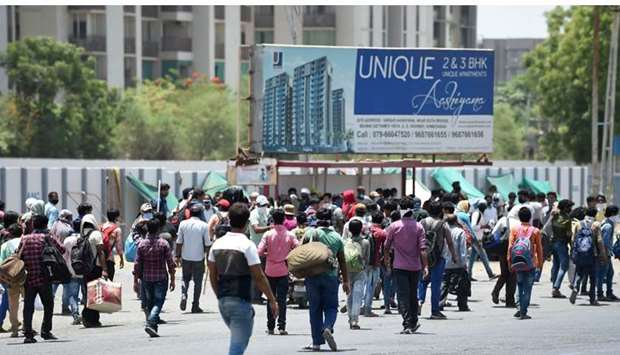 Stranded migrant workers intending to go to their hometowns, leave Gota Bridge area -Gujarat
