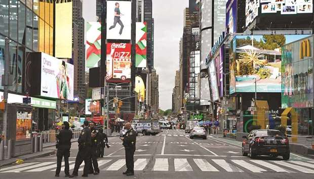 Police officers are seen in New York City's Times Square following reports of three people, includin