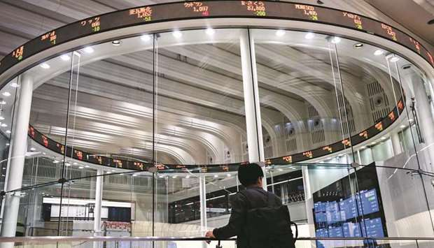 An electronic ticker displays share prices at the Tokyo Stock Exchange. The Nikkei 225 closed up 0.6
