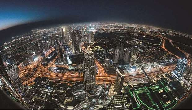 Picture taken with a fish-eye lens on May 9 shows a view of the Dubai city skyline as seen from the