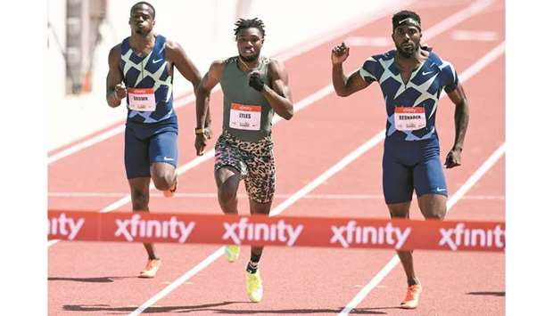 Noah Lyles beats Kenny Bednarek and Aaron Brown to win the 200m dash during the USATF Golden Games a