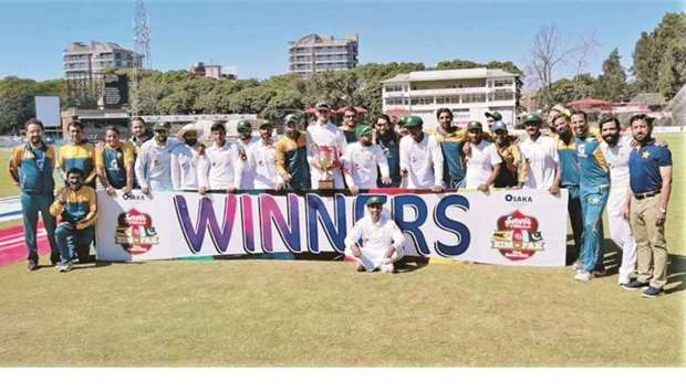 Pakistan players and officials celebrate their Test series victory over Zimbabwe in Harare yesterday