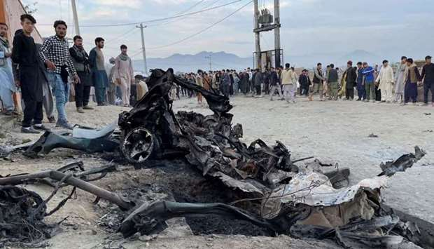 People stand at the site of a blast in Kabul, Afghanistan May 8, 2021. REUTERS