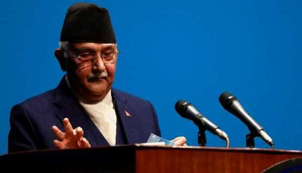 Nepal's Prime Minister Khadga Prasad Sharma Oli, also known as K P Oli, delivers a speech before a c