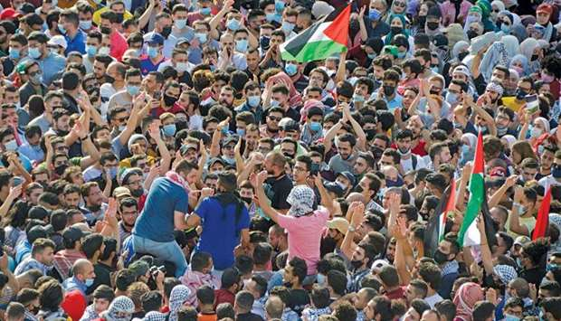 Jordanians demonstrate to express solidarity with the Palestinian people, near the Israeli embassy i