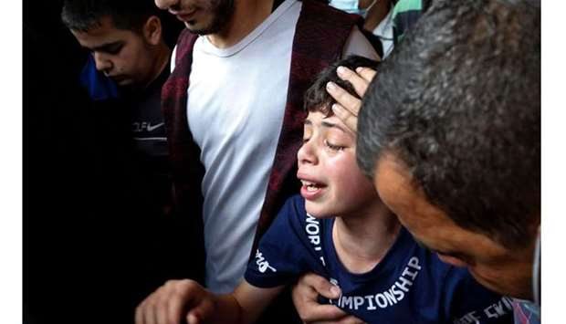 Palestinians mourn during a funeral in Jabalia in the northern Gaza Strip