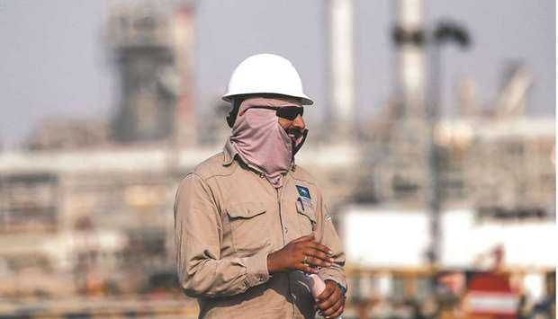 An employee looks on at the Saudi Aramco oil facility in Abqaiq (file). Indian state refiners reques