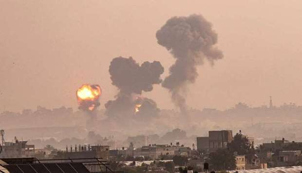 A fire billows from Israeli air strikes in Khan Yunis, in the southern Gaza Strip