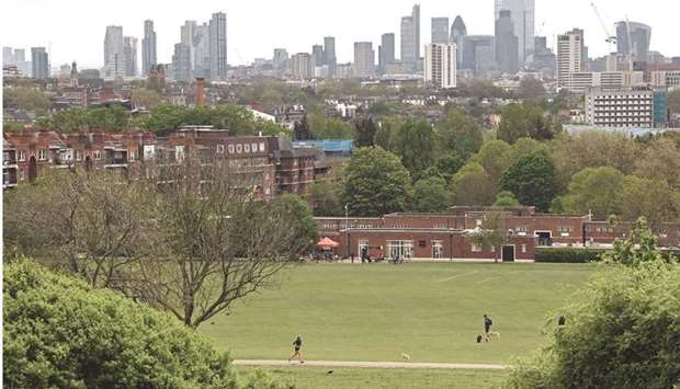 The London skyline is pictured from Hampstead Heath. Britain's economy began to recover strongly at