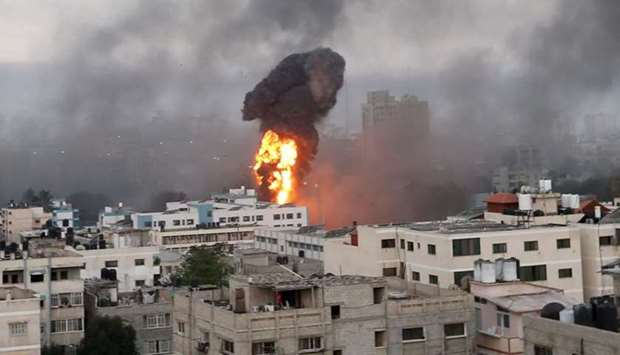 Smoke and flames rise during Israeli air strikes in Gaza