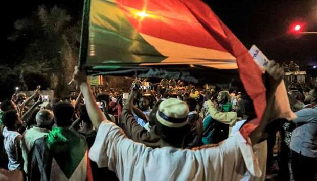 Demonstrators gather outside the army headquarters in Sudan's capital Khartoum yesterday which corre