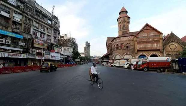 In a file photo, a man rides his bicycle during a lockdown in Mumbai (Reuters)