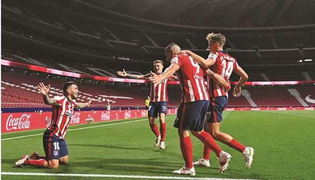Atletico Madrid's Angel Correa (left) celebrates with teammates after scoring against Real Sociedad