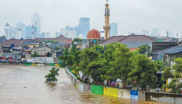 File photograph shows a general view of flooded residential houses after a heavy rain in Jakarta.