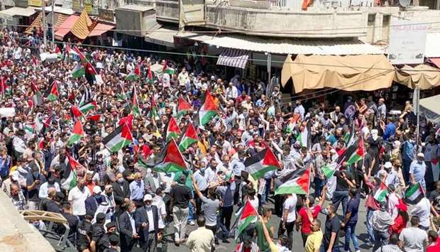 Demonstrators take part in a protest to express solidarity with the Palestinian people, in downtown