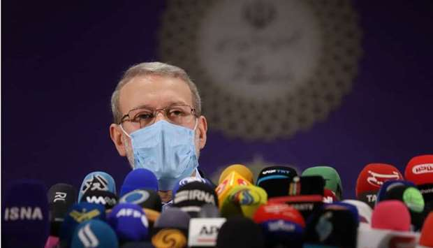 Ali Larijani, former chairman of the parliament of Iran, speaks at a press conference after register