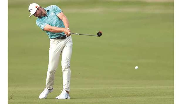 Sam Burns hits from the fairway on the 18th hole during the round two of the Byron Nelson championsh