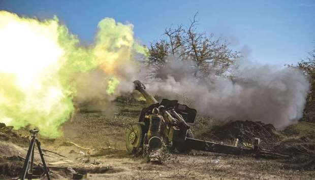 In this file photo taken on October 25, 2020, an Armenian soldier fires artillery on the front line