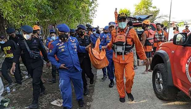 Rescuers carrying the body of a victim after a boat carrying 20 holiday-makers capsized on May 15 at