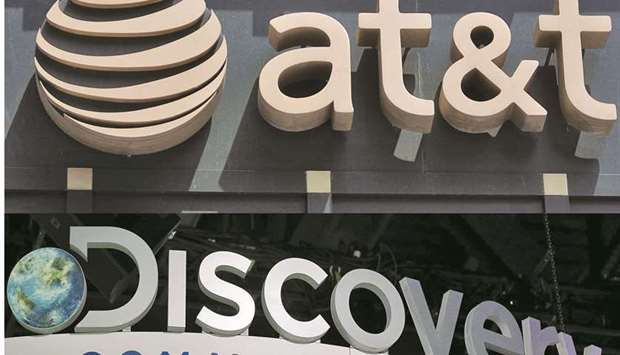 The AT&T logo is displayed outside a store in Washington, DC. AT&T is in talks to combine its media