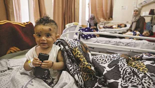 A Palestinian child, who was wounded in Israeli air strikes on the Gaza Strip, receives treatment at