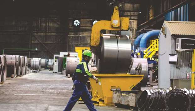 A finished steel coil is lifted and moved at the NLMK Pennsylvania plant in Farrell. The European Un
