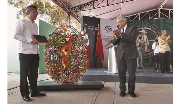 Chinese ambassador to Mexico Zhu Qingqiao and Mexican President Andres Manuel Lopez Obrador take par