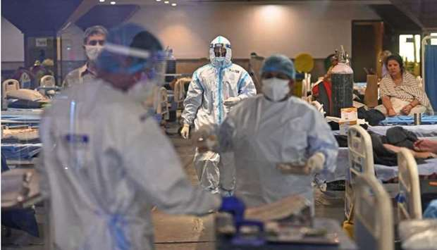 Health workers wearing PPE suits (Personal Protection Equipment) can be seen at a banquet hall turne