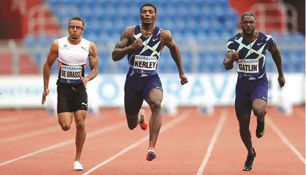 Fred Kerley (centre) of the US wins the men's 100m ahead of compatriot Justin Gatlin (right) and Can