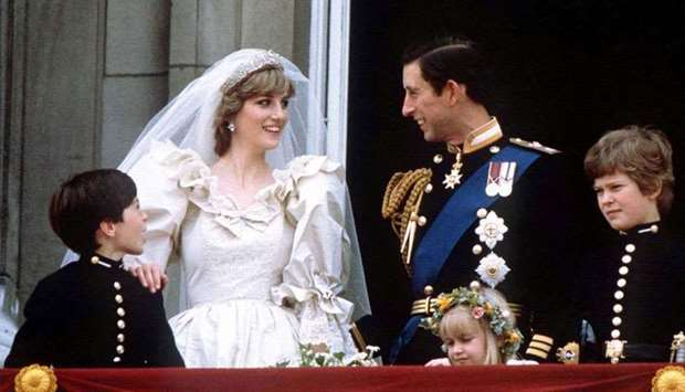 (File photo) Prince Charles and Princess Diana stand on the balcony of Buckingham Palace in London,