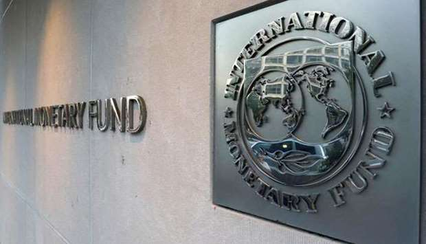 (File photo) International Monetary Fund (IMF) logo is seen outside the headquarters building in Was
