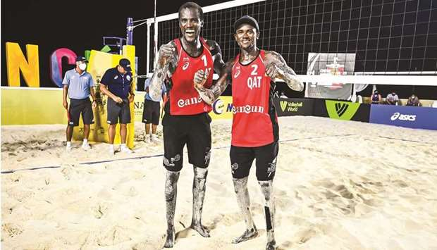 Qatar's Cherif Younousse and Ahmed Tijan celebrate their win in the semi-final of the third tourname