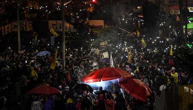 Demonstrators take part in a protest against the government of Colombian President Ivan Duque, at th