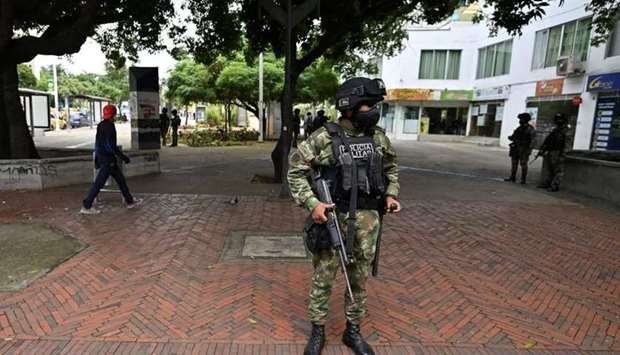 A Colombian soldier stands guard in a street the day after protests against the Colombian President