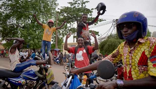 Supporters of Malian Armed Forces (FAMA) gather at Independence square in Bamako on May 28, 2021 to