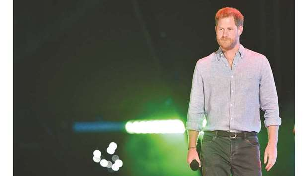 Britain's Prince Harry, Duke of Sussex, arrives onstage to speak during the taping of the 'Vax Live'