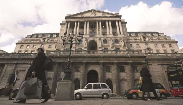 Pedestrians pass the Bank of England in London. The UK's economic rebound from the pandemic is fuell