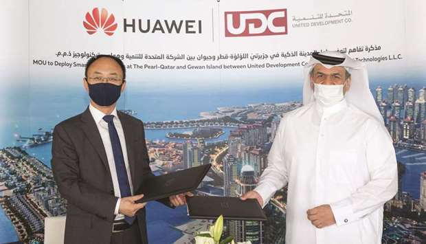 UDC president and CEO and member of the board Ibrahim Jassim al-Othman and Huawei Qatar CEO Fan Tao