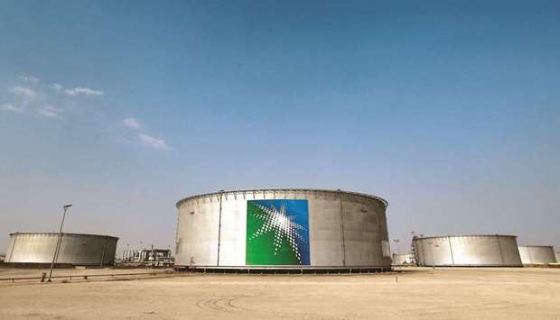 A view of branded oil tanks at Saudi Aramco oil facility in Abqaiq (file). The reductions had been a
