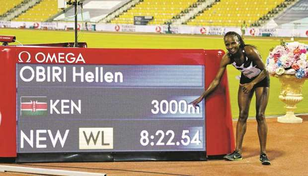 In this September 25, 2020, picture, Kenya's Hellen Obiri celebrates after setting a world leading t