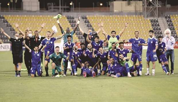 Al Khor players and support staff celebrate after their win over Al Shahania in the play-off at the