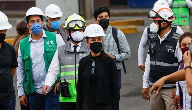 Mexico City's Mayor Claudia Sheinbaum visits the site a day after an overpass for a metro partially