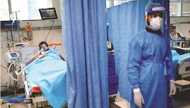 A man suffering from coronavirus disease (Covid-19) receives treatment as a Syringe Infusion Pump, d