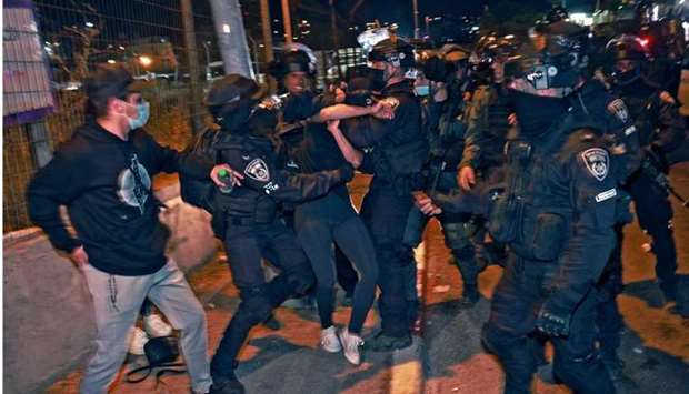Israeli policemen clash with  protesting Palestinians. AFP