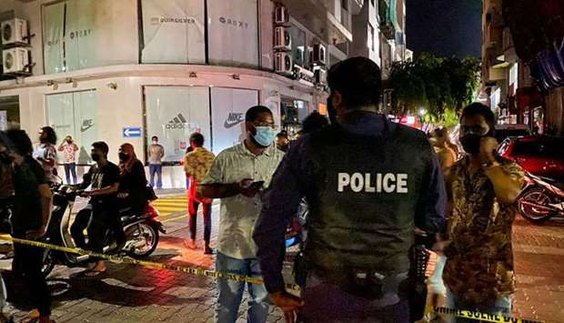 Police secure a site after a suspected bomb blast injured former Maldives president and current parl