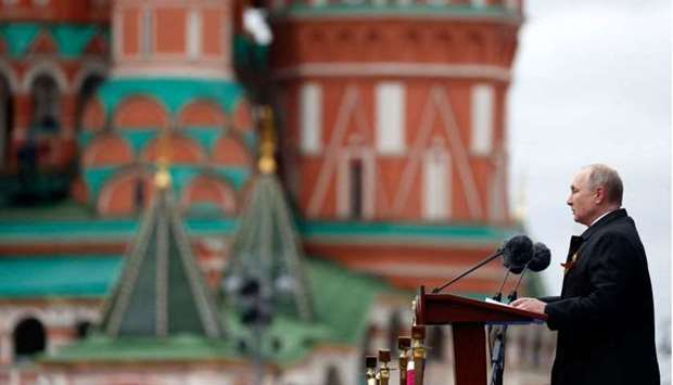 Russian President Vladimir Putin gives a speech during the Victory Day military parade at Red Square