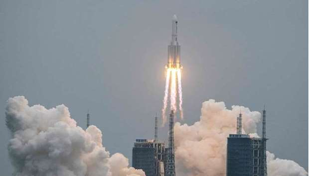 This file photo taken on April 29, 2021 shows a Long March 5B rocket, carrying China's Tianhe space