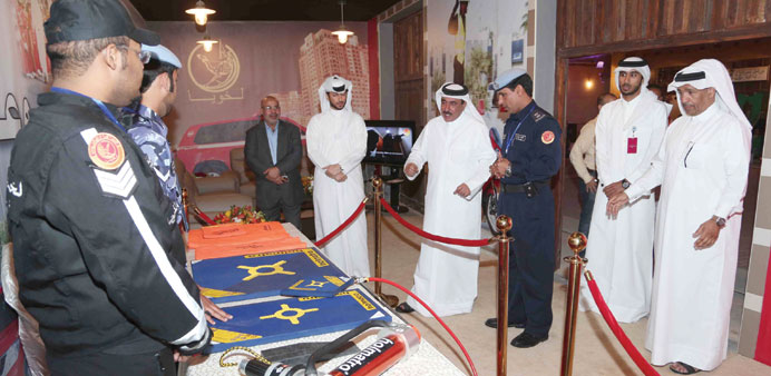 HE the Transport Minister Jassim Seif Ahmed al-Sulaiti and others at one of the pavilions at the exh